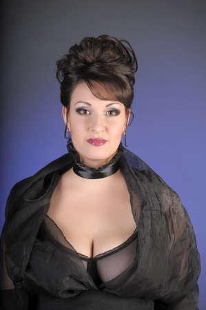 portrait of a beautiful brunette in a black dress Stock Photo - 15335891