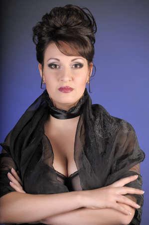 portrait of a beautiful brunette in a black dress Stock Photo - 15335897