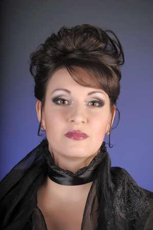 portrait of a beautiful brunette in a black dress Stock Photo - 15335895