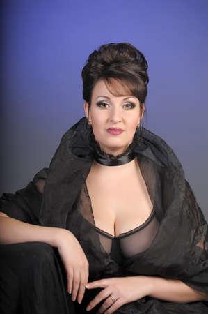 portrait of a beautiful brunette in a black dress  photo