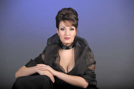 portrait of a beautiful brunette in a black dress  Stock Photo - 15335870