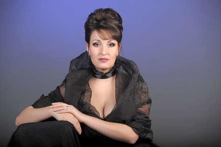 portrait of a beautiful brunette in a black dress Stock Photo - 15335866