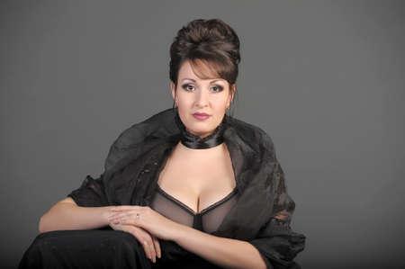 portrait of a beautiful brunette in a black dress Stock Photo - 15335867