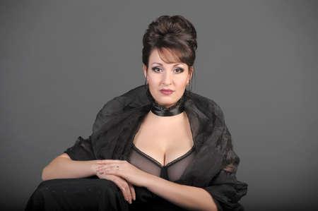 portrait of a beautiful brunette in a black dress Stock Photo - 15335869
