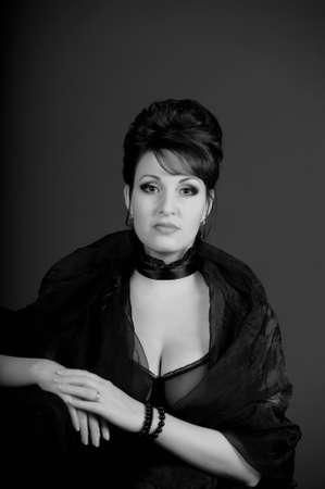 portrait of a beautiful brunette in a black dress Stock Photo - 15335860