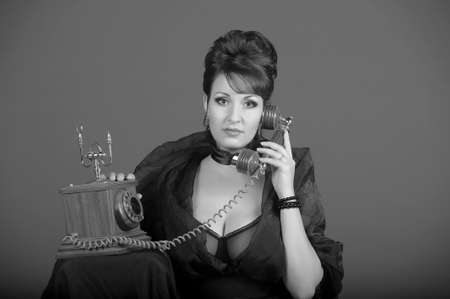 The sexual woman speaking by phone. A vintage Stock Photo - 11954464