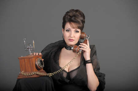 The sexual woman speaking by phone. A vintage Stock Photo - 11954471