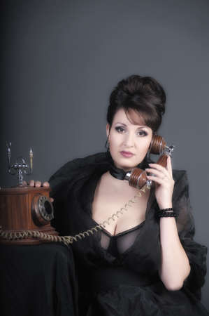 The sexual woman speaking by phone. A vintage Stock Photo - 11954462