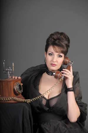 The sexual woman speaking by phone. A vintage Stock Photo - 11954478