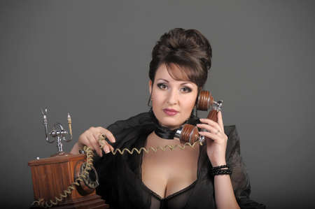 The sexual woman speaking by phone. A vintage Stock Photo - 11954475