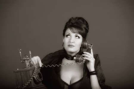 The sexual woman speaking by phone. A vintage photo