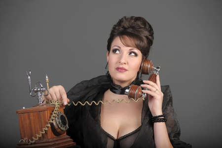 The sexual woman speaking by phone. A vintage Stock Photo - 11954473