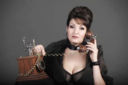 The sexual woman speaking by phone. A vintage Stock Photo - 11954458