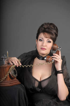 The sexual woman speaking by phone. A vintage Stock Photo - 11954483
