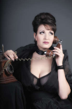 The sexual woman speaking by phone. A vintage Stock Photo - 11954466