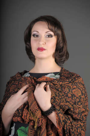 The beautiful Russian woman in a scarf on shoulders photo