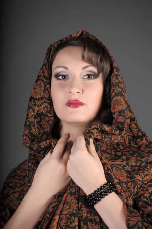 The beautiful Russian woman in a scarf on a head Stock Photo - 11953467