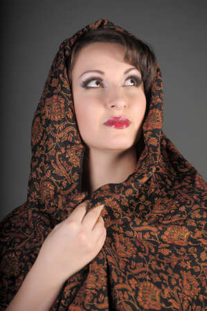 The beautiful Russian woman in a scarf on a head Stock Photo - 11953470
