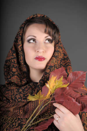 The beautiful woman in a palatine with autumn leaves Stock Photo - 11953010
