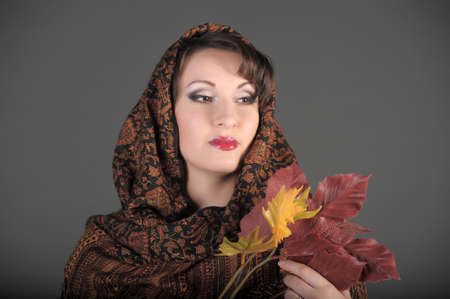 The beautiful woman in a palatine with autumn leaves photo