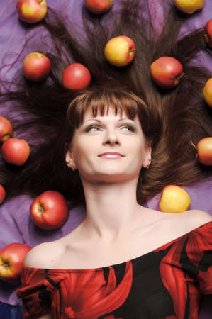 girl lying with apples Stock Photo - 11869435