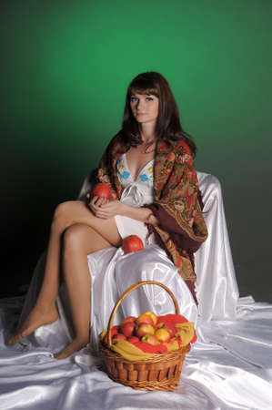 The young beautiful woman in Russian scarf with apples Stock Photo - 11961272