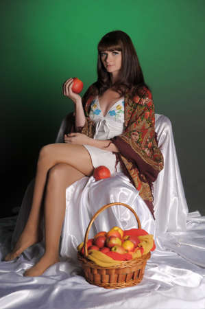 The young beautiful woman in Russian scarf with apples in hands Stock Photo - 11961268