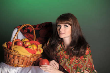 The young beautiful woman in Russian scarf with apples Stock Photo - 11961270
