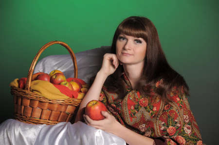 The young beautiful woman in Russian scarf with apples Stock Photo - 11961284
