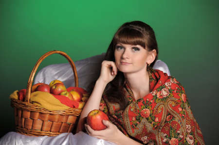 The young beautiful woman in Russian scarf with apples Stock Photo - 11961283
