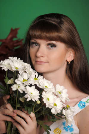 young woman with daisies photo