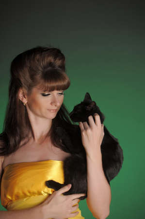 Young woman with a black cat photo