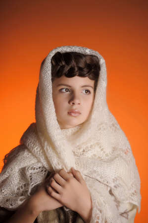 Russian girl with a pigtail and a fluffy shawl photo