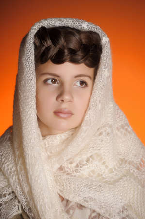 Russian girl with a pigtail and a fluffy shawl Stock Photo - 12009668