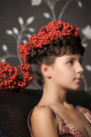 Girl with ashberries Stock Photo - 13304555