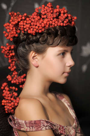 Girl with ashberries Stock Photo - 13304570