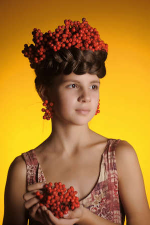Girl with ashberries photo