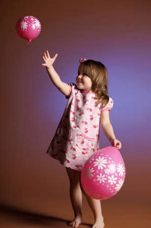 Cute little girl with balloons photo