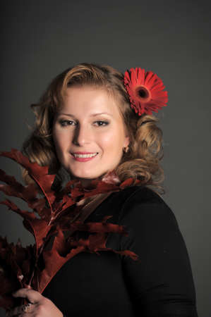 The young woman with  Gerbera in hair photo