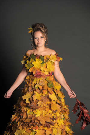 woman with a dress made of autumn leaves Stock Photo - 11422485