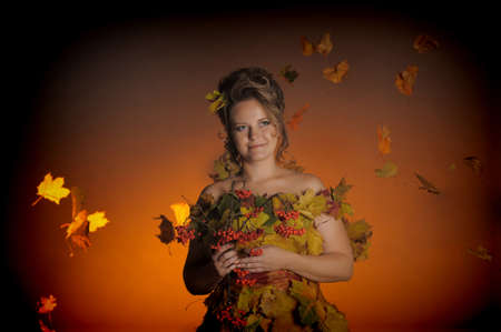 woman with a dress made of autumn leaves Stock Photo - 11422464