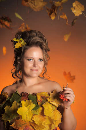 woman with a dress made of autumn leaves Stock Photo - 11422476