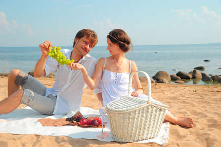 Couple having romantic picnic photo