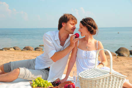 Young romantic couple on the beach photo