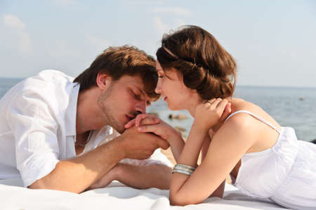 passionate kissing: Young romantic couple on the beach