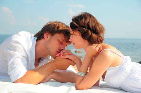gentle dream vacation: Young romantic couple on the beach
