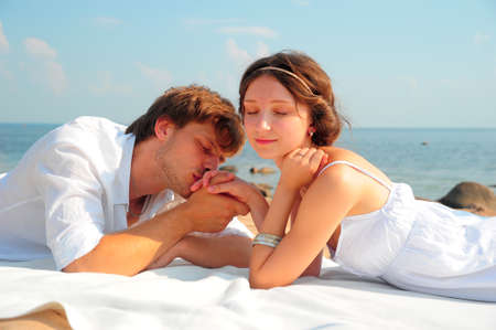 russian man: Young romantic couple on the beach