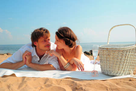 gentle dream vacation: young couple in love on the shore Stock Photo