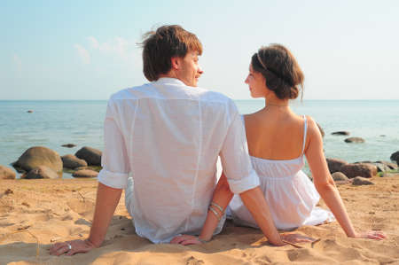 Rear view of a couple sitting on beach Stock Photo - 11471866