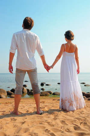Natural couple at the beach  Stock Photo - 11420766